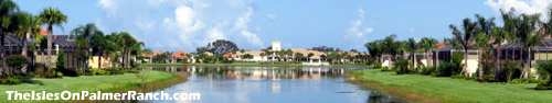 View of the clubhouse across the lake. Many homes within The Isles on Palmer Ranch enjoy a spectacular lake view such as this. Take in a Sarasota sunset from your patio.